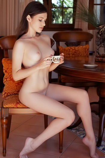 Cup of coffee and orange pantyhose for breakfast at home