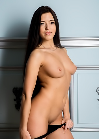 Raven haired beauty posing naked all over the floor
